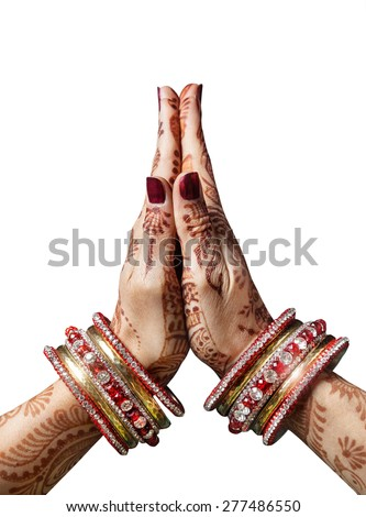 Woman hands with henna in Namaste mudra on white background  - stock photo