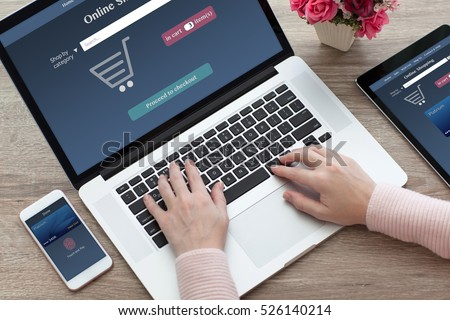 woman hands with laptop notebook and computer tablet phone with online shopping