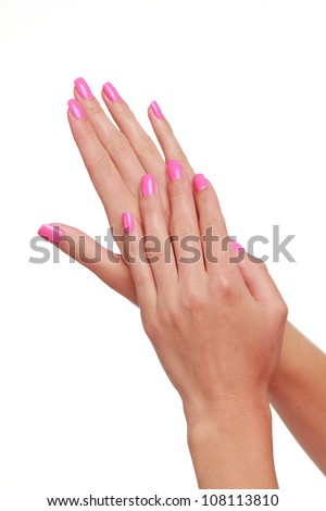 woman hands with lovely pink manicure over white background/spa theme - stock photo