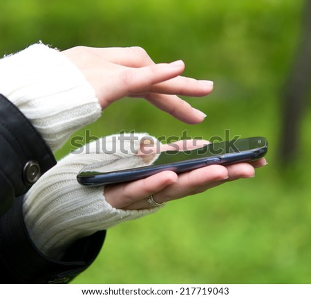 woman hands with mobile phone