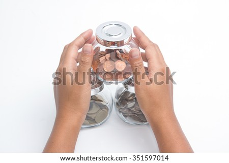 Woman hands with money in glass jar ,Protection of retirement savings - stock photo