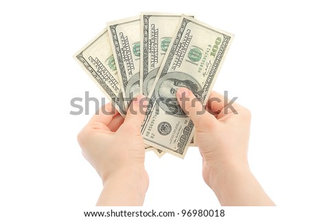 Woman hands with money on white background - stock photo