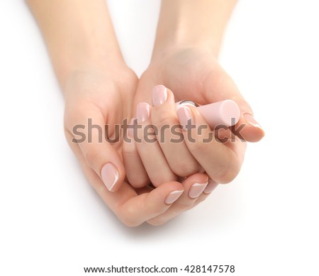 Woman hands with nail polish isolated on white background - stock photo