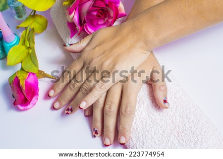 Woman hands with painted nails and manicure - stock photo