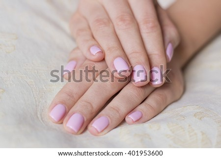 Woman hands with pink nails