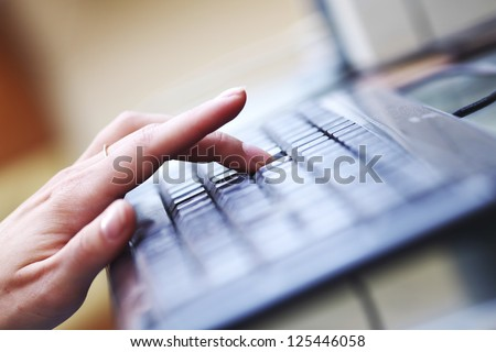 woman hands working on keyboard - stock photo