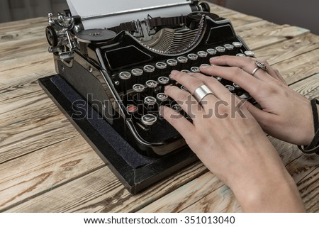 Woman Hands writing on old typewriter. creative process of writing a new novel. The inspiration for the writer's work - stock photo