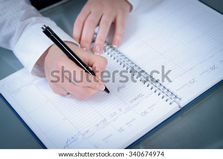 woman hands writing plans at notebook