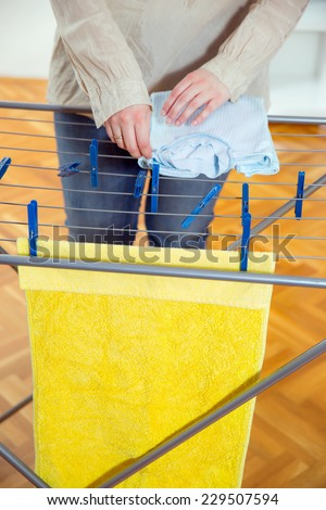 Woman hanging clothes - stock photo