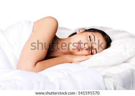 Woman happily beauty sleeping in white bed and dreaming, isolated. - stock photo