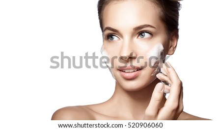 Woman happy cleans the skin foam on a white background isolated