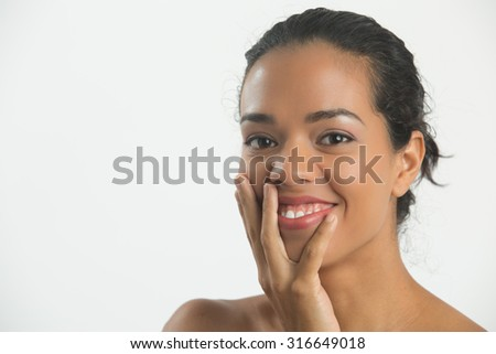 Woman happy ,touching her cheek and looking  camera