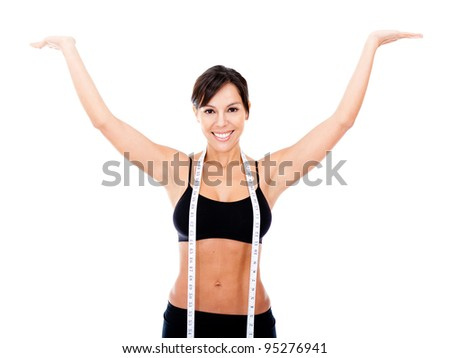 Woman happy with her weight loss - isolated over a white background - stock photo
