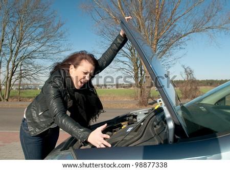 woman has a car breakdown - stock photo
