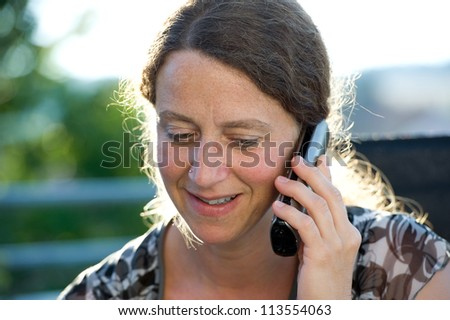 woman has a good telephone call