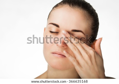 Woman has pain in her eyes, healthcare concept - stock photo