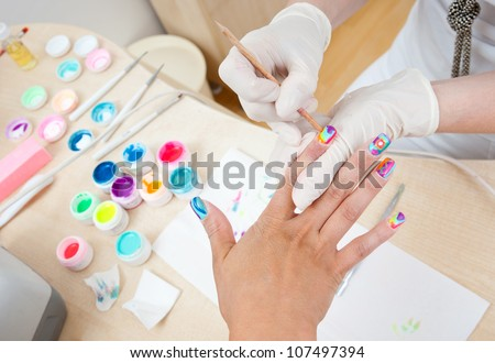 woman have nail coloring treatment in manicure salon - stock photo
