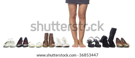 Woman having a hard time choosing what shoes to wear. - stock photo