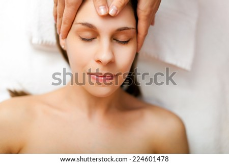 Woman having a massage in a spa