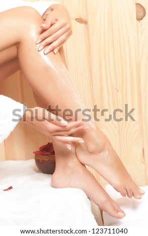 woman having a massage in beautiful legs - stock photo