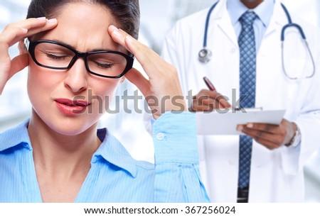 Woman having a migraine headache. - stock photo