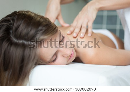 Woman having a relaxing massage - stock photo