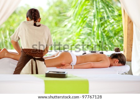 Woman having a relaxing massage at a spa - stock photo