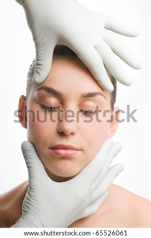 Woman having beauty treatment on face, plastic surgery - stock photo