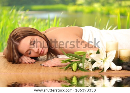 woman having body care in an sp - stock photo