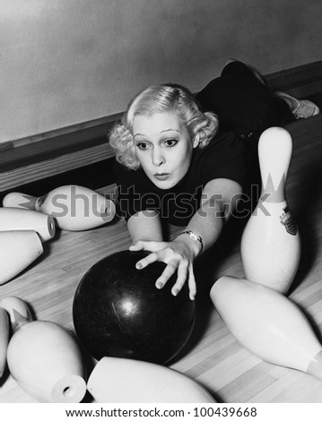 Woman having bowling accident - stock photo