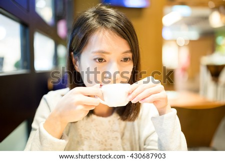 Woman having coffee in cafe shop