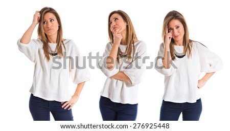 Woman having doubts over white background