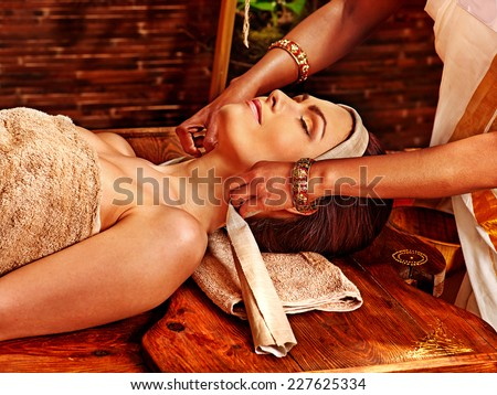 Woman having facial  ayurveda spa treatment. - stock photo
