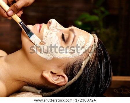 Woman having facial mask at ayurveda spa.. - stock photo