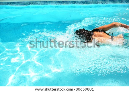 Woman having fun in swimming pool.