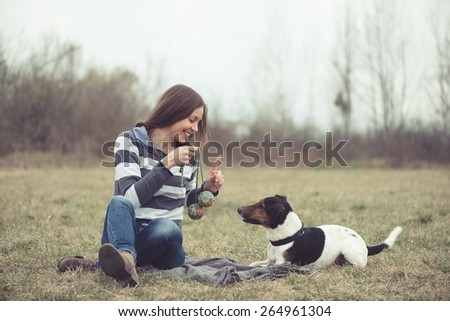 Woman having fun with her dog - stock photo