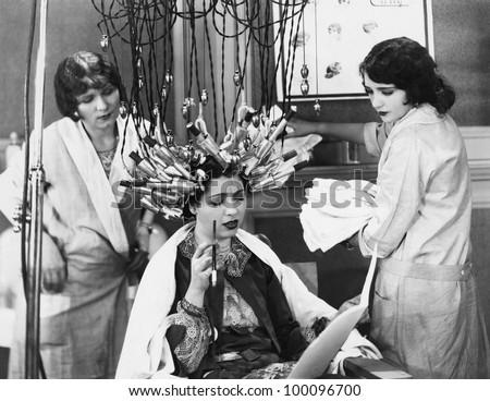 Woman having hair done in salon - stock photo