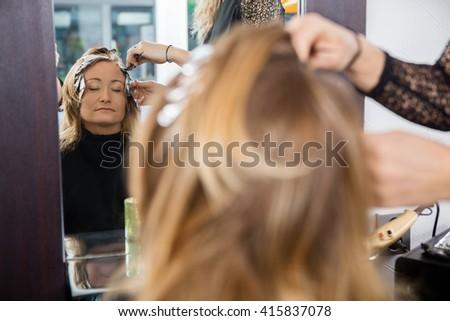 Woman Having Hair Dyed At Beauty Parlor - stock photo
