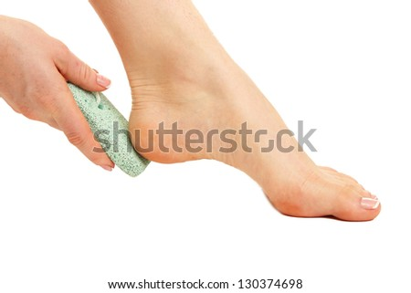 Woman having her foot scrubbed, isolated on white - stock photo