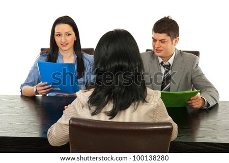 Woman having interview with two young business people isolated on white background