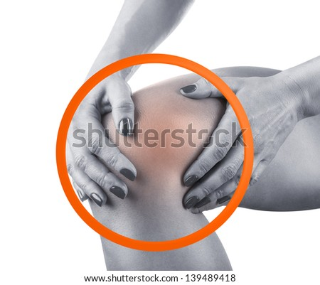 Woman having knee pain isolated on a white background - stock photo