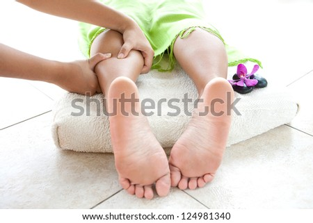 Woman having leg massage at spa - stock photo