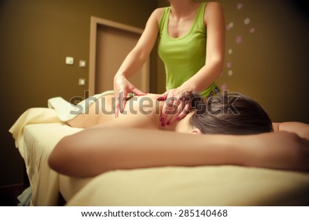 Woman having massage of body in the spa salon. Beauty treatment concept.Woman lying and relaxing