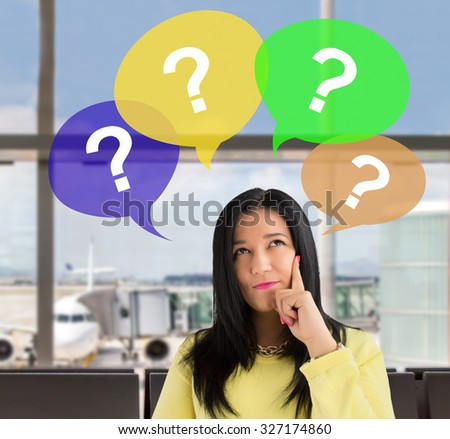 woman having questions at the lobby of the airport - stock photo