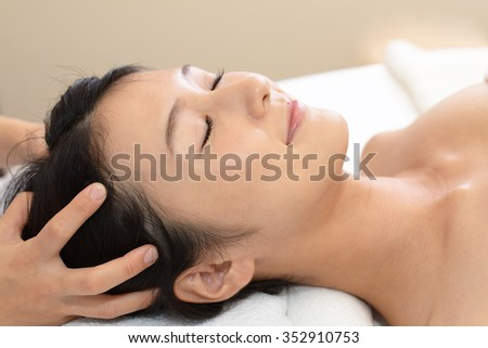 Woman having relaxing massage in spa salon