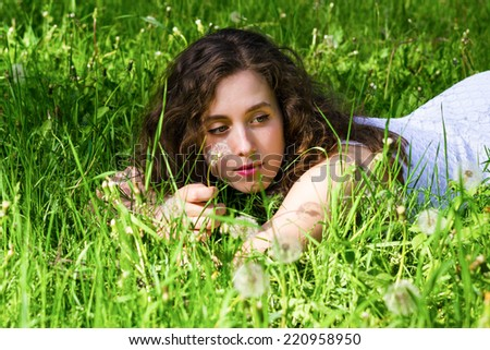 Woman having rest on meadow - stock photo