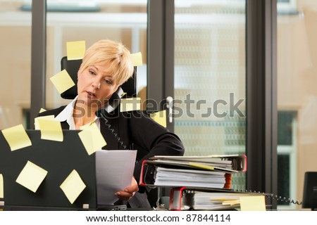 woman having stress in the office - multitasking and time management - stock photo