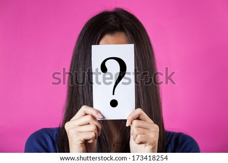 Woman Hiding Face Behind a Question Mark - stock photo