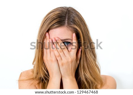 woman hiding face laughing timid on white background - stock photo