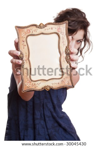Woman hiding face with an picture frame